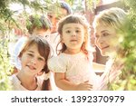 happy playful family outdoors.... | Shutterstock . vector #1392370979