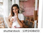 green eyed smiling woman in... | Shutterstock . vector #1392438653