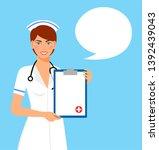 beautiful female nurse is... | Shutterstock . vector #1392439043