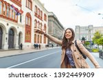 young woman hailing a taxi ride.... | Shutterstock . vector #1392449909