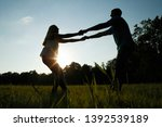 lovers walk on nature.... | Shutterstock . vector #1392539189