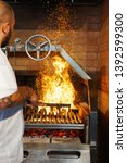 bbq food and machine fire | Shutterstock . vector #1392599300