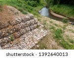 stacks of rock in wire for... | Shutterstock . vector #1392640013