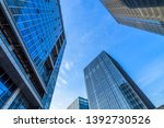 low angle view of skyscrapers... | Shutterstock . vector #1392730526