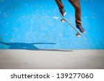 Skater Jumps High In Air Under...