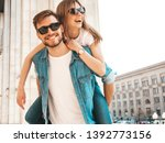 smiling beautiful girl and her... | Shutterstock . vector #1392773156