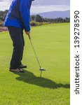 man on green putting a ball | Shutterstock . vector #139278590