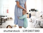 toddler girl is embarrassed and ... | Shutterstock . vector #1392807380