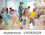 joyful kids and clown playing...   Shutterstock . vector #1392820229