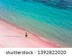 Man Walking On The Pink Sand...