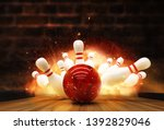 Small photo of Bowling strike hit with fire explosion. Concept of success and win.