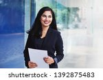 young successful indonesian... | Shutterstock . vector #1392875483