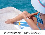 woman applying suncream on the... | Shutterstock . vector #1392932396