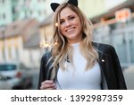 outdoor photo of young... | Shutterstock . vector #1392987359