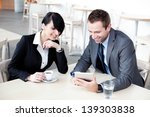 Business meeting. Businesswoman and businessman in restaurant, talking. - stock photo