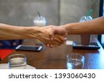 two men join hands for business ... | Shutterstock . vector #1393060430