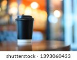 a cup of coffee on wooden table ... | Shutterstock . vector #1393060433