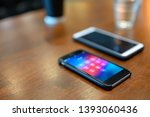 mobile phone placed on the wood ... | Shutterstock . vector #1393060436