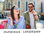 attractive young couple... | Shutterstock . vector #1393093499
