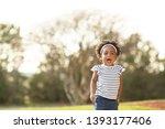 happy african american little...   Shutterstock . vector #1393177406