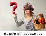 A Woman In Hair Curlers  A...