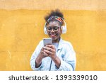 afro american girl using mobile ... | Shutterstock . vector #1393339010