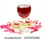 wine and burning candles  | Shutterstock . vector #139345688