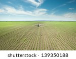 Tractor Spraying Soy In The...