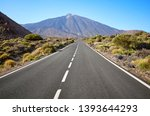 scenic road with mount teide in ... | Shutterstock . vector #1393644293