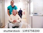 male orderly pushing senior... | Shutterstock . vector #1393758200