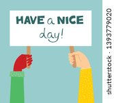 have a nice day. hands holding... | Shutterstock .eps vector #1393779020