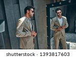 handsome stylish man in beige... | Shutterstock . vector #1393817603