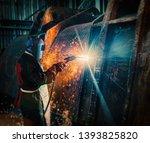 African Worker Welding A...