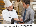 waiter and chef discussing the... | Shutterstock . vector #139385570