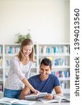 students in a library   looking ... | Shutterstock . vector #1394013560