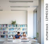 students in a library   looking ... | Shutterstock . vector #1394013563