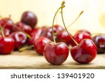 Fresh Red Cherries On A Wooden...