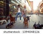 Stock photo happy dog walker walks dogs and enjoying outdoors 1394048126