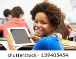 pupil in class using digital...   Shutterstock . vector #139405454