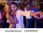 young couple having fun at a... | Shutterstock . vector #13940905