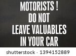 Small photo of Sign to inform motorists that it would be very unwise to leave any valuables in their cars