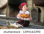 little girl in traditional... | Shutterstock . vector #1394162390