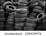 Old Used Tires Stacked With...