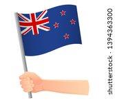 new zealand flag in hand.... | Shutterstock .eps vector #1394363300