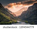 Small photo of zap river and snowy mountain peak at sunrise of the hakkari