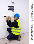 electrician at work in a house | Shutterstock . vector #1394692589
