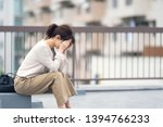 depressed young asian woman... | Shutterstock . vector #1394766233