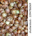 group of onions with peels