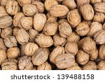 Background of walnuts with shell. - stock photo