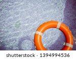 Orange Life Buoy In The Pool....
